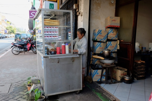 Baguette prepared while we wait, in Vientiane