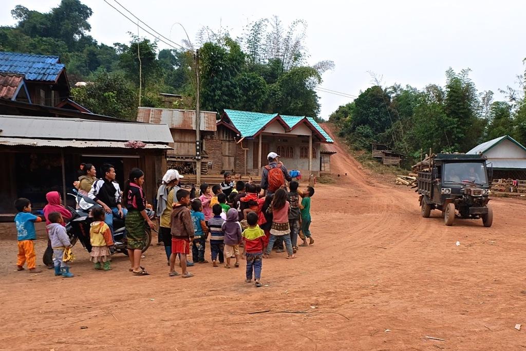 John's turn to be mobbed by kids near Luang Prabang