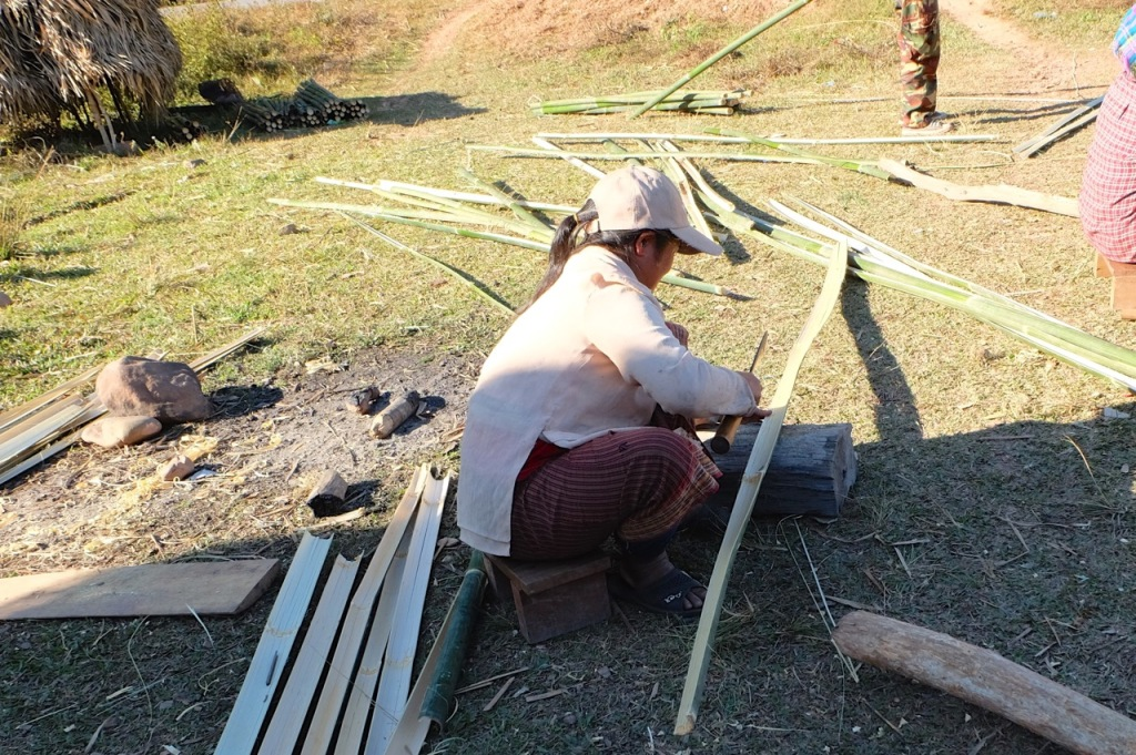 Preparing bamboo for the walls of a hut