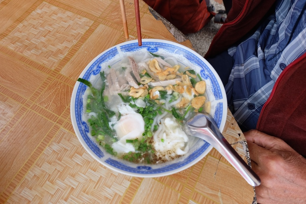 Pork noodle soup with egg.