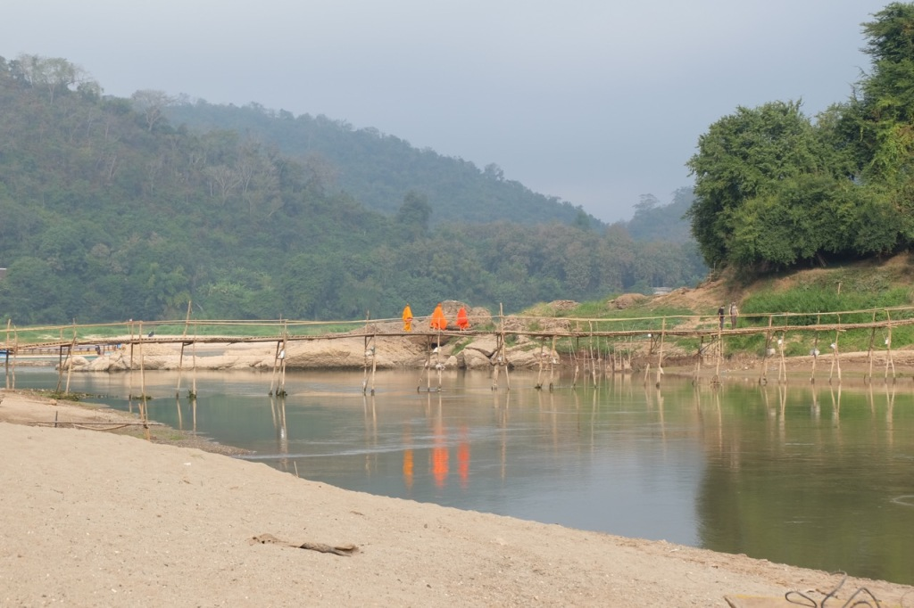 Monks crossing the footbridge over the Nam Khan at Luang Prabang