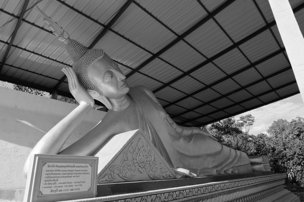 Reclining Buddha which is situated being the Stupa, That Luang Namtha