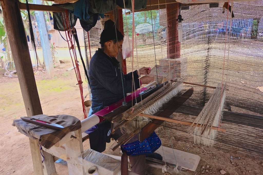 Weaver and her traditional loom, photo taken near Luang Namtha