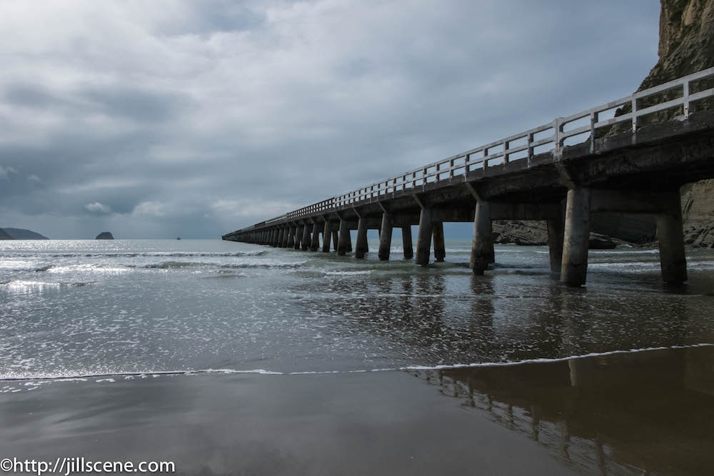 Tolaga Bay Wharf disappearing into the Ocean