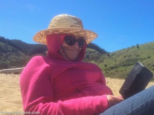 At the beach, last spring. A southerly was blowing, it was cold, but I couldn't put my book down.